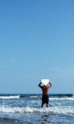 surfer on beachfront